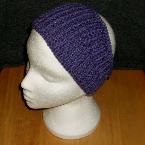 Purple coloured knitted headwear, handmade by Longhaired Jewels
