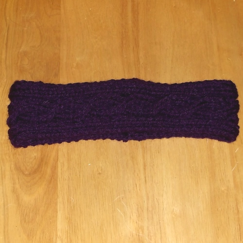 Cable knit headband handmade and sold by Longhaired Jewels